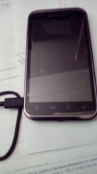 Smartphone Alcatel one touch noir + filtre + coque la batterie ne se charge plus