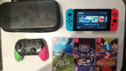 Nintendo switch + 6 jeux +house + protège écran