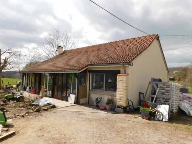 Maison plain pied d'environ 110 m2 habitable avec garage sur